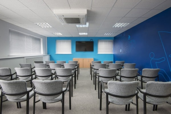 "Open Space Meeting Room 3 (OS3) theater style - Perfect for our 65"" TV. Accessible location nearby worcester"